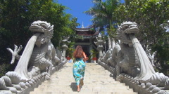 girl climbs up the stairs. staircase decorated with statues of dragons - stock footage
