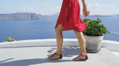 Travel Tourist Woman Walking In Oia Santorini - Lady visiting famous destination Stock Footage
