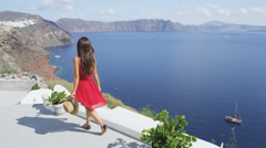 Tourist at Santorini Caldera View of Aegean Sea At Famous Travel Destination Stock Footage