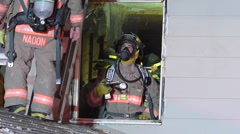 Firefighters Work Inside Home Through Window Stock Footage