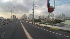 Vehicle point-of-view of bus driving toll Highway Stock Footage