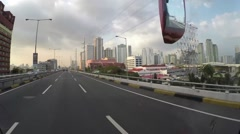 Vehicle point-of-view of bus driving toll Highway - stock footage