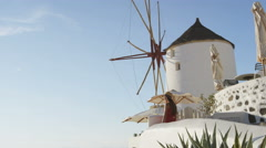 Tourist Standing By Windmill In Oia Santorini - Greek Islands Travel Vacation Stock Footage