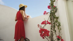 Tourist Woman Looking At View In Santorini At Famous Travel Destination - stock footage