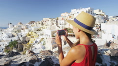 Woman Tourist Photographing Village on Santorini At Famous Travel Destination - stock footage