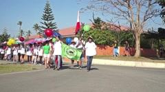 Senior citizens parade on the street Stock Footage
