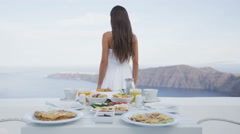 Breakfast Table On Terrace with Woman Walking By - Well balanced perfect meal Stock Footage