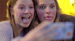 Fun Teen Girls Sit At An Outdoor Cafe And Take Silly Selfies Together - stock footage