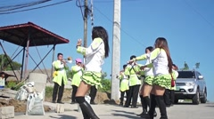 Majorettes dancing exhibition on street Stock Footage
