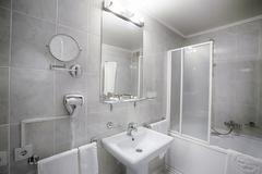 Interior of a modern hotel bathroom - stock photo