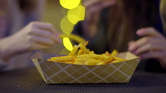 Closeup Of Teen Girls Grabbing Fries From Large Basket Stock Footage