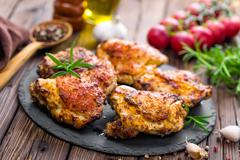 Chicken thighs Stock Photos