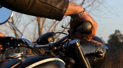 The Biker Starts the Motorcycle Engine at Sunset. Stock Footage