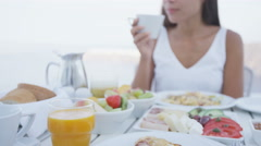 Woman Drinking Coffee During Breakfast Outdoors - woman eating meal at outside Stock Footage