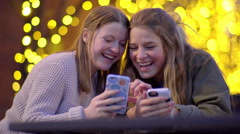 Teen Shows Her Friend Something Funny On Her Smartphone, They Laugh - stock footage