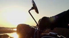 The Hand Adjusting the Rear View Mirror of Motorcycle at Sunset. Stock Footage