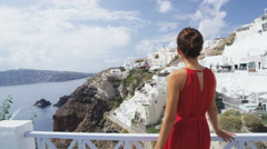 Tourist Enjoying Holidays Travel Santorini Greece - Woman traveler in Oia - stock footage