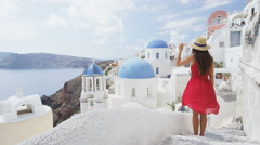 Europe Tourist Travel Woman In Oia Santorini At Famous Landmark Destination - stock footage