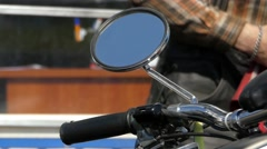 the Rear-View Mirror in the Motorcycle. - stock footage