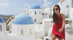 Tourist On Santorini Climbing Stairs In Oia - Woman traveler at destination Stock Footage