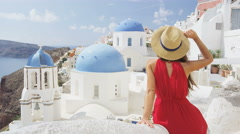 Tourist Enjoying The View Of Oia Village Santorini - Woman traveler at landmark Stock Footage