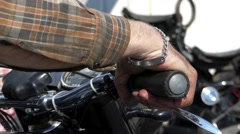 Biker Holds the Handle of a Retro Motorcycle. Closeup. - stock footage