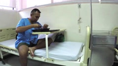 Wounded soldier eating his food ration at hospital bed - stock footage