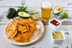 Nachos chips with sauces beer and avocado - stock photo