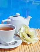 Cup of tea on a saucer and teapot. Stock Photos