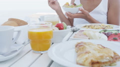 Woman Having Bowl Of Fruit Salad During Breakfast Eating Healthy Food in Morning - stock footage