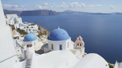 Santorini Oia Blue Domed church And Caldera At Famous Travel Destination - stock footage