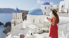 Woman Using Mobile Smart Phone App On Summer Travel Vacation On Santorini - stock footage