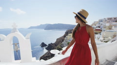 Santorini Tourist Walking Looking At Caldera View At Famous Travel Destination - stock footage