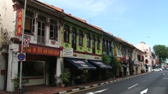 Bus and cars pass by the historical street in Singapore, Singapore. Stock Footage