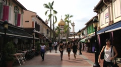 People walk by the pedestrian street in the Arab quarter in Singapore. Stock Footage