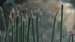 Religious incense smoke burning in temple Stock Footage