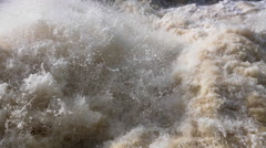 Rough stream of water discharge at a dam Stock Footage