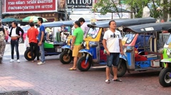 Stock Video Footage of Thai tuk-tuk vehicles waiting for passengers, Bangkok . Thailand