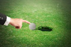 Cheating in golf - stock photo