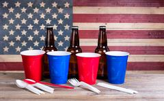 Fourth of July party items on wood - stock photo