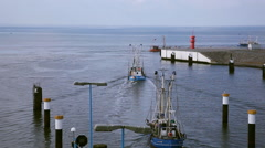 Fishing boats put out to sea Stock Footage