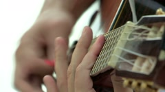 Hands playing guitar. Close up of fingers and hand playing a music instrument. Stock Footage