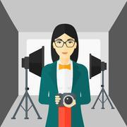 Smiling photographer holding camera - stock illustration