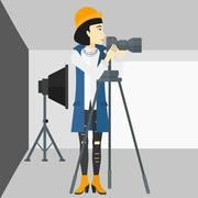 Photographer working with camera on a tripod - stock illustration