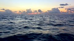 Open seas. Open water. Ocean waves during sunset golden hour time. Stock Footage