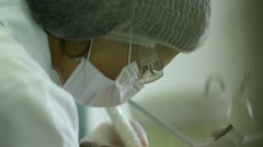 Female dentist doctor at her office working Stock Footage