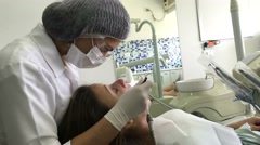 Female doctor examining patient. Dentist office Stock Footage