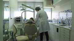 Female dentist doctor at her office working. Doctor and patient Stock Footage