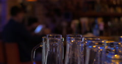 Glassware and man with pad in cafe Stock Footage