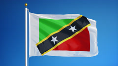 Saint Kitts and Nevis flag in slow motion seamlessly looped with alpha Stock Footage